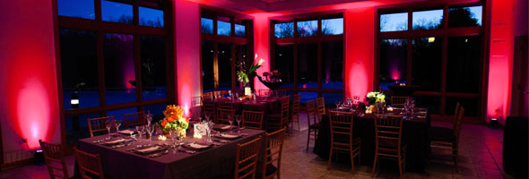 red uplighting at wedding dinner event